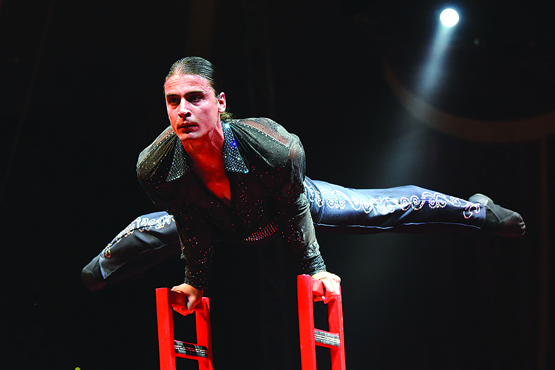 Alex Cooper / Recorder staff    Christian Bilea balances on a numerous amount of chairs by using upper body strength during the Shriners Circus on Saturday, September 3rd, in Perth.